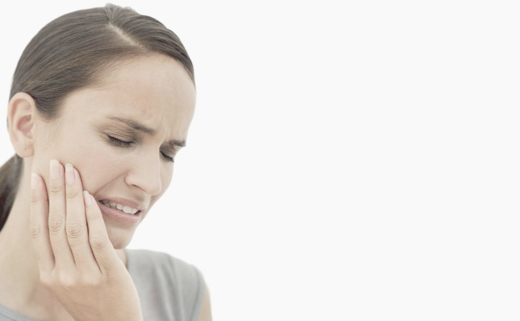 Girl touching her face. Looks like she has a tooth pain.